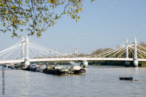 River Thames London  from Chelsea  Embankment with Albert Bridge and barges on r Poster