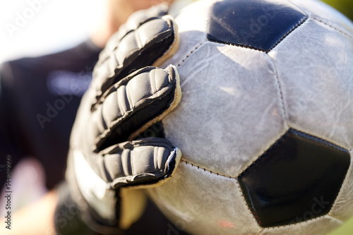 close up of goalkeeper with ball playing football