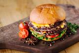 Juicy beef burgers on wooden background - 144108153
