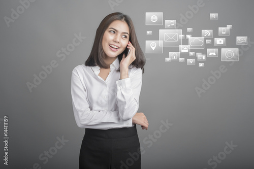 Beautiful business Woman using smartphone on grey background Poster