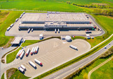 Aerial view of warehouse with trucks. Industrial background. Logistics from above.  - 144112727
