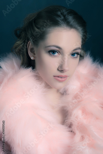 Sensual retro 1940s glamour portrait of young woman wearing feather boa Poster