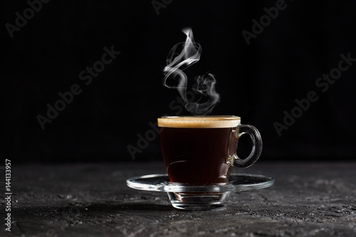 Fotobehang Koffiebonen Steamy Coffee on Dark Background