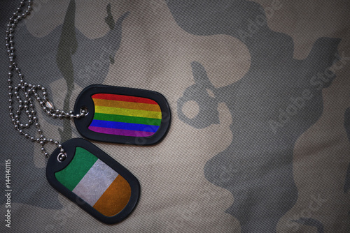 army blank, dog tag with flag of ireland and gay rainbow flag on the khaki texture background Poster