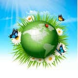 Fototapeta  Ecology concept.Green Globe and Grass with Flowers. Vector illustration.