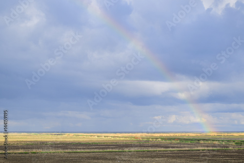 Poster Rainbow, a view of the landscape in the field. Formation of the