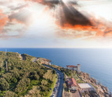 Sunset over beautiful Tuscany coastline, aerial view