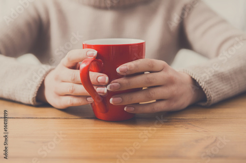Poster Close-up of woman with cup of hot drink