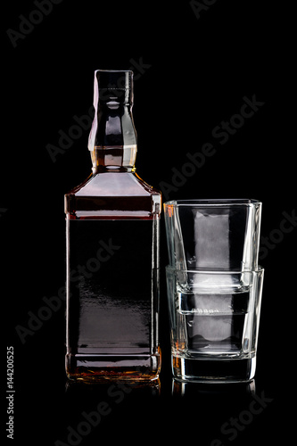 Bottle of whiskey and two empty glasses Poster