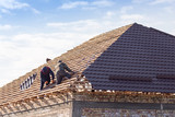 workers working on the roof - 144202321