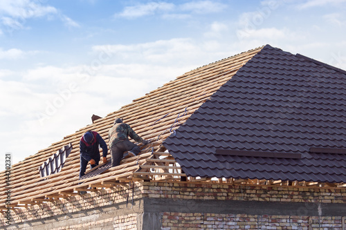 workers working on the roof