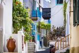 Narrow street of a small mediterranean town Mandraki on the Nisyros island in Greece