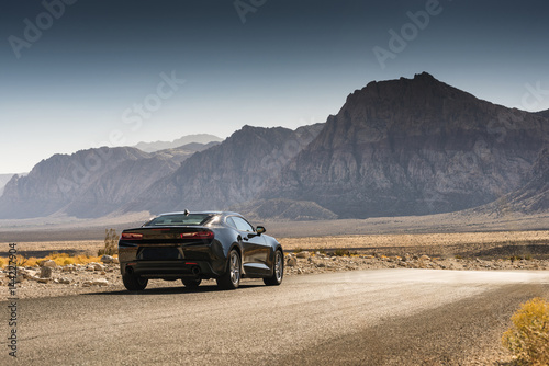 Plakat Black Sports Car on a Desert Road