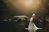 Young woman in fairy pond - 144236798