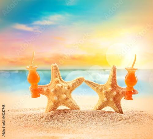 Crazy starfish having fun on beach