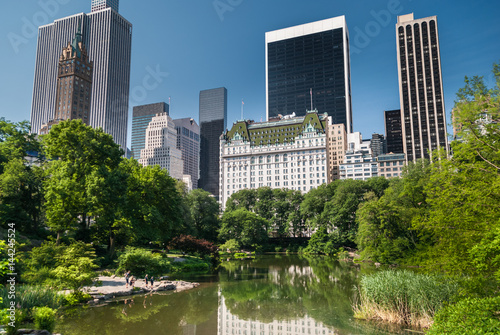 New York skyscrapers reflecting in the Central Park pond