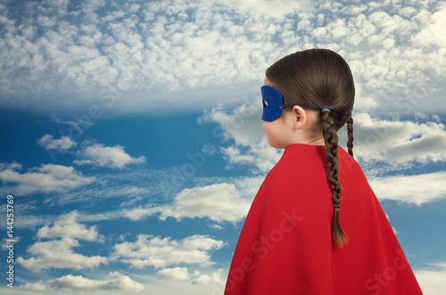 Cute little super hero girl in the red cloak. Superhero concept Poster