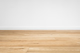 new wooden floor  - parquet floor and white wall background  - 144255153