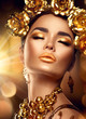 Golden holiday makeup. Golden wreath and necklace. Fashion art hairstyle, manicure and makeup