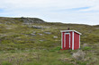 Lone red shed in a barren Newfoundland landscape