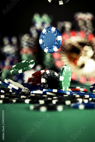 Poster Casino Concept background with dice, roulette and chips.