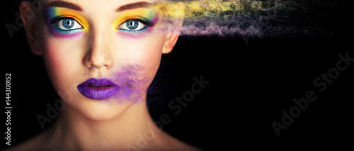Fashion model girl portrait with colorful powder make up. Beauty woman with bright color makeup. Close-up of Vogue style lady face, Abstract colourful make-up, Art design. Black background. copy space