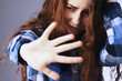Постер, плакат: I am very afraid Sad woman scared putting hand in front of face Gestures body language psychology