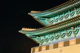 Close up of Gwanghwamun Gate, the main gate of Gyeongbokgung Palace in Seoul, South Korea at night
