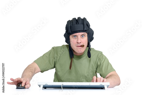 Poster Funny man in tank helmet and cigar playing in game, sitting front of computer