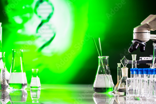 Science Concept. microscope with lab glassware, laboratory research and development