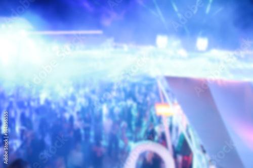 Tuinposter Gymnastiek Blurry night club dj party people enjoy of music dancing sound with colorful light. club night light dj party Ibiza club. With Smoke Machine and lights. Dark background.