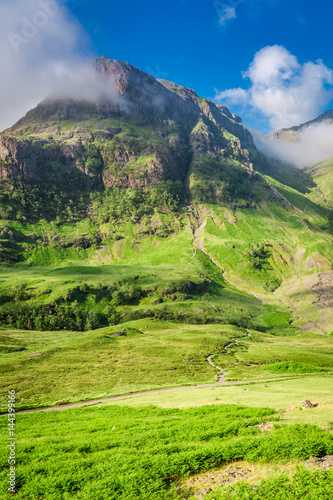Wonderful mountains of Glencoe at sunrise in summer, Scotland Poster