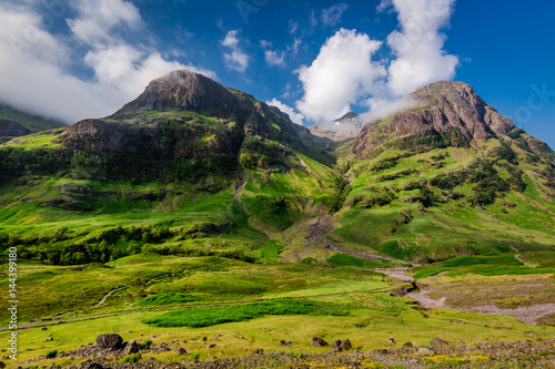 Mountains of Glencoe at sunrise in summer, Scotland