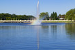 Early summer morning photo of one of the fountains in the lake at Wascana Park in Regina, Saskatchewan, Canada. There's a rainbow at the base of the spray!