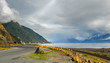 Alaska road along water at Turnagain Arm with clouds
