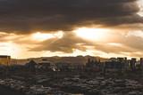 Sun Shining Through Clouds Over Las Vegas Skyline