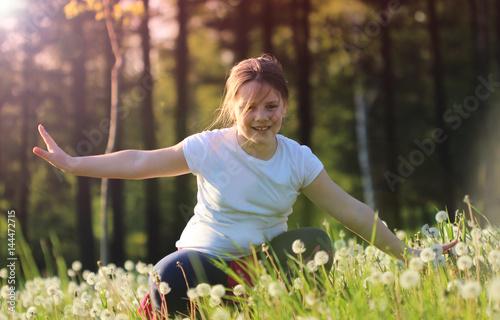 Little girl in the dandelions Poster