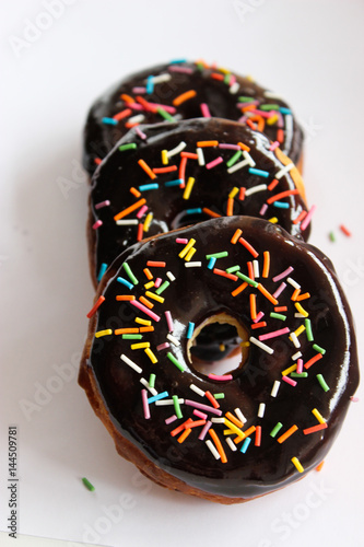 Poster Lush donuts with chocolate icing and bright sprinkles
