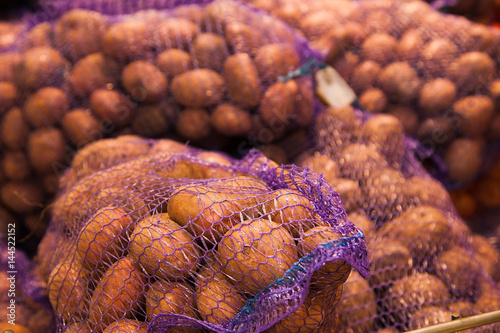 Potatoes in supermarket stand