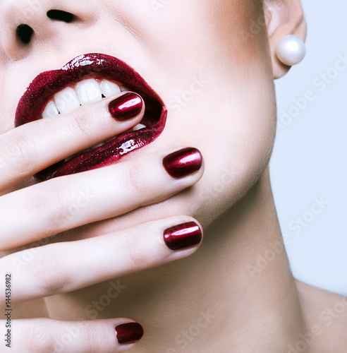 Part of face close up, red lips and nails Poster