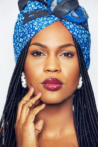 Pretty young black woman in blue headscarf