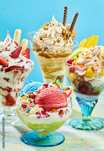Three delicious ice cream sundaes on table