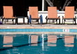 Orange chairs and their reflections in a pool of a resort in Scottsdale