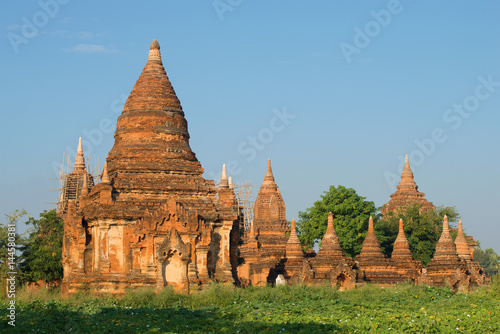 Poster Ancient Buddhist temple complex on a sunny morning. Bagan, Burma