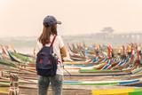 Young women traveler looking at U bein bridge