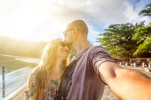 Beautiful young couple doing selfie on the beach, vacation, holiday, honeymoon concept