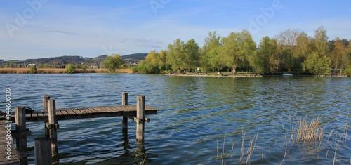 Fotobehang Pier Gangplank at lake Pfaffikon. Auslikon, place popular for swimming and recreation.
