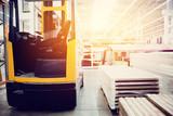 Building materials warehouse, logistics concept, construction of houses, loader. - 144626344