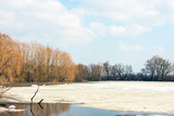 Early spring, melting snow and ice, the forest lake is freed of ice 1