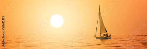 Sailboat at sunset Poster